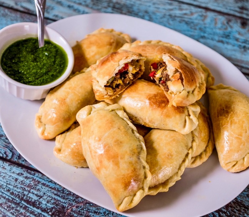 Tue - Organic Grass feed baked empanadas with fresh chimichurri (turnovers) Image