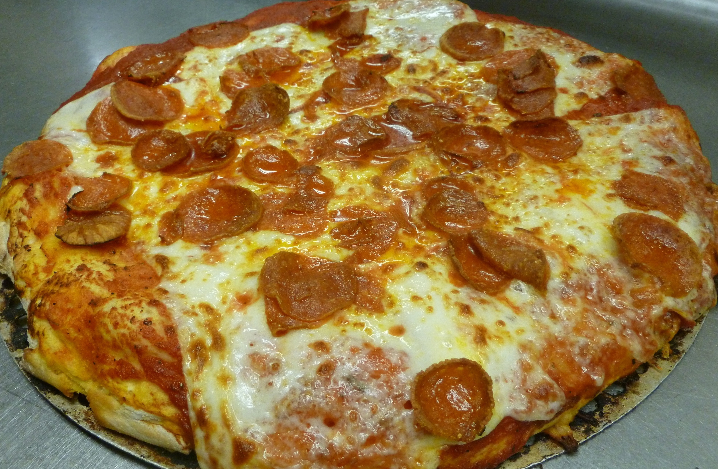 $12 LG 1-topping *ONLINE ONLY SPECIAL* Image