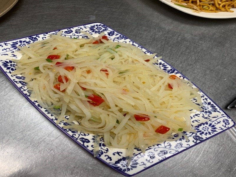 64. Sauteed Shredded Potato in Hot Sour 酸辣土豆丝 Image