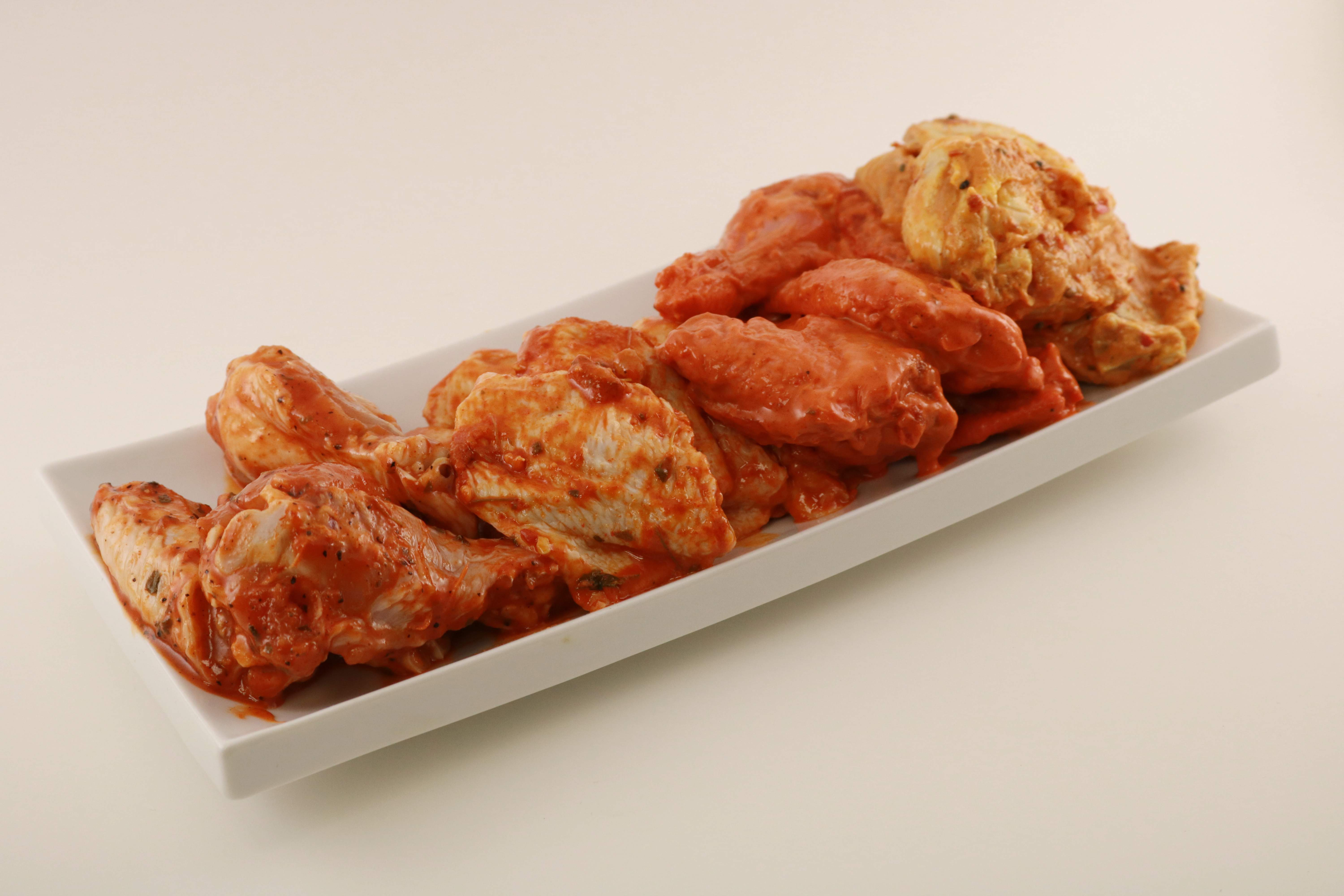 Raw Marinated Wings Image