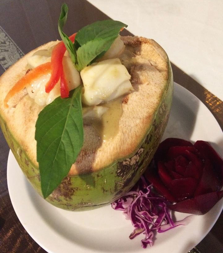 H5. Young coconut seafood in Green Curry Sauce Image