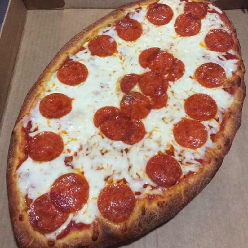 Large Football Shaped Pizza Image